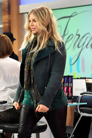 Fergie sported this dark teal motorcycle jacket for a cool and edgy look.