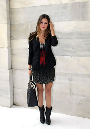 Rachel Bilson showed off her stylish side at the Roberto Cavalli show in a lace-up pair of ankle boots.