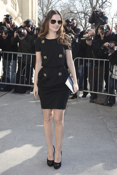 Virginie donned an LBD with square brass buttons for the Chanel fashion show in Paris.