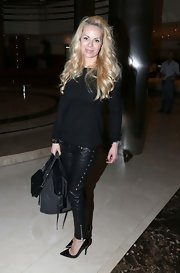 Helena Seger was edgy-chic in a black boatneck sweater and leather skinnies at the Al-Sadd Sports Club Stadium.
