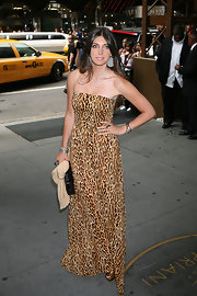 Brittny wore a smashing, animal-printed evening gown with oversized jewels and a black clutch.