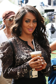 La La Anthony appeared on 'Extra' wearing a long-sleeve leopard-print blouse.