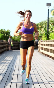 Kelly Benisom kept things stylish on her run in his purple spaghetti strap sports bra.