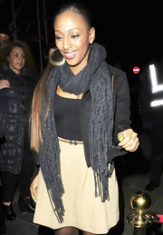 Alexandra Burke accessorized with a thick knit scarf to the Rose nightclub.