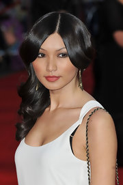Gemma Chan stepped onto the red carpet at the premiere of 'Titanic 3D' wearing her silky tresses in long polished waves.