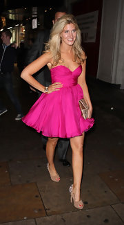 Francesca Hull paired her fluffy fuchsia dress with tan suede peep toe pumps featuring small silver spikes.