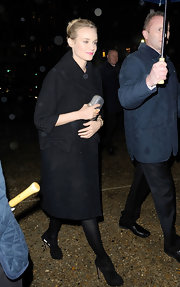 Diane Kruger was spotted at the Prada show in a black wool coat with stylish cropped sleeves.