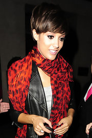 Frankie Sandford kept warm with a fiery red leopard and skull print scarf.