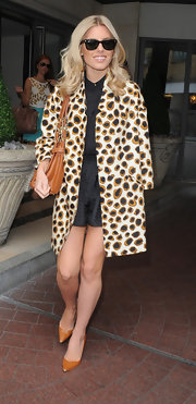 Mollie King made a big and bold statement with this oversized, leopard-print coat, which she donned while out in London.