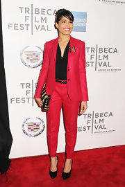 Freida Pinto paired her sporty red suit with classic black pumps.