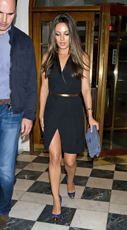 Mila Kunis updated her sexy LBD with a air of blue Metalipp pumps. The gold cap toes of the heels matched the shine of her bronze waist belt.