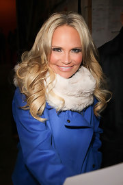 Kristin Chenoweth signed autographs after an appearance on 'Live! With Kelly' wearing her long locks in bouncy curls.
