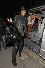 Kelly Rowland went clubbing in black suede platform over-the-knee boots.