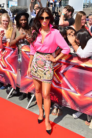 Nicole Scherzinger looked pretty in pink in this pink button down top, which she paired with a funky abstract-print skirt.