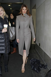 Gemma's structured gray coat had a sleek streamlined cut that still showed off her killer silhouette.