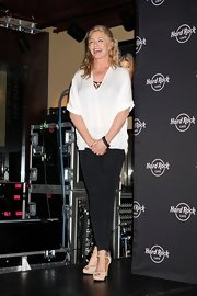 Shannon Tweed was all smiles at Hard Rock Cafe in a laid-back yet still stylish ensemble featuring a loose sheer top and black leggings.