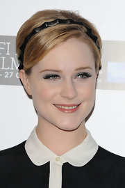 Evan Rachel Wood's pixie cut with the addition of a headband helped create her adorable style for 'The Ides of March' screening in London.