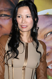 Wendi Deng had her waves tied half up at the Global Poverty Project event.