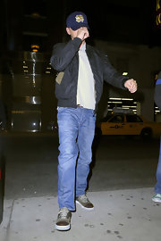 Leonardo DiCaprio was spotted wearing tricolor suede sneakers while on his way to watch a Broadway musical.