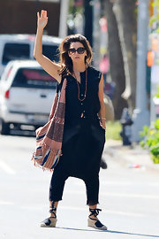 Gina Gershon accessorized with a printed hobo bag to cut her monochromatic palette during a day out in New York.