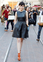 Ginnifer Goodwin wore this funky leather dress with orange shoes for her appearance on 'Extra.'