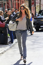 Gisele Bundchen chose a classic black leather jacket to pair over her tee while out in NYC.