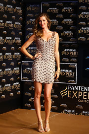 Gisele Bundchen definitely reminded us why her nickname is 'The Body' when she sported this gold beaded bandage dress.