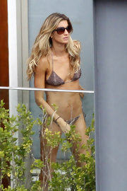Gisele was beach ready with tousled blond locks.