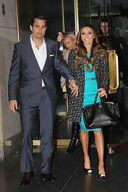 Giuliana topped off her vibrant dress with black and white cap toe pumps.