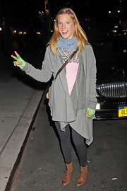 Heather Morirs was mad about layers in a long gray duster, two scarves and green fingerless gloves.