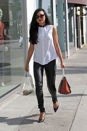 Naya Rivera paired a sleeveless button down with skinny leather pants for a modern and chic look while out in LA.