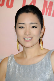 These fringe gold earrings were a nice pop against Gong Li's silver dress.