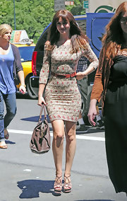 Leighton Meester added a chic touch to her ribbed floral dress with a brown leather Chyc Cabas tote.