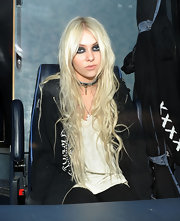 Taylor Momsen showed off her sleek center part curls at a promotional event in London.