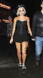 Pixie puts the grr in tiger with her wild ensemble. She wore a classic black corset with a little black skirt and tiger body paint.