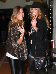 Delta Goodrem accessorized with a stylish Prada leather shoulder bag at the Gotye concert.