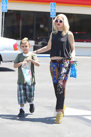 A sleeveless blouse topped off Gwen Stefani's boho-inspired look while out with her kids.