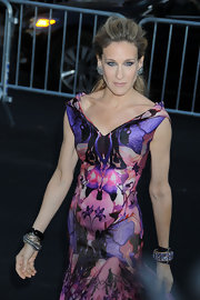 Sarah Jessica Parker paired her diamond stud earrings with a colorful Alexander McQueen dress.