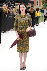Dita carried a burgundy umbrella that matched her outfit perfectly.