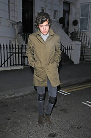 Harry Styles' skinny jeans had a bit of a funky flare to them with leather patches on the knees.