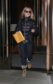 Hayden Panettiere bundled up in a blue puffer jacket for a casual an athletic look.