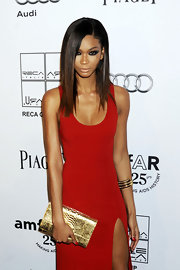 Chanel Iman attended the amfAR Gala wearing a curve hugging red dress and sleek straight tresses. Subtle highlights at the ends were the perfect complement to her bronzed skin.