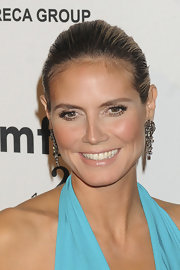 Heidi attended the amfAR Gala wearing gemstone earrings. It was the perfect way to accent her slick updo.