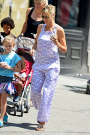 Heidi Klum wore a playful purple print overall jumpsuit while out with her kids for ice cream.
