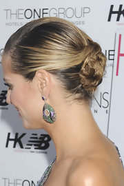 Heidi Klum twisted her locks into a chic low bun that was pinned into place. A deep side part put the finishing touch on her elegant hairstyle.