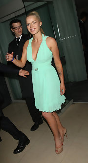 Helen Flanagan rocked a teal cocktail dress with a halter neckline and a pleated skirt for her look at FHM's Sexiest Woman Launch Party in London.