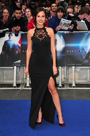 Lucy Watson showed a peek of leg with this black gown that featured a lace neckline.