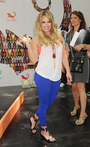 Hilary Duff topped off her casual look with a red beaded necklace.