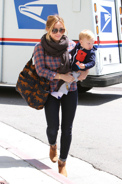 Hilary Duff chose a stylish diaper bag to carry while out with her son Luca in LA.