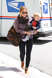 Hilary Duff looked cozy and comfy in this blue and red plaid button down, which she wore while out in LA with her son.